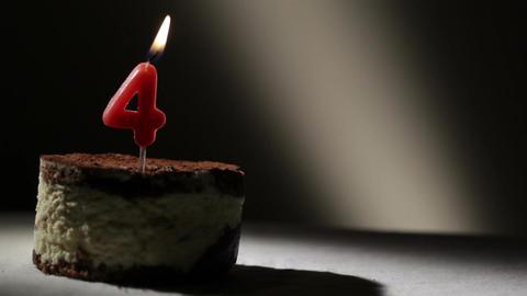 Candle four in tiramisu cake Stock Video Footage