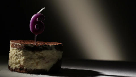 Candle six in tiramisu cake Stock Video Footage