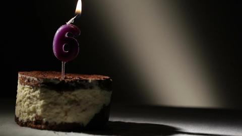 Candle six in tiramisu cake Stock Video Footage