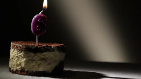 Candle six in tiramisu cake Footage