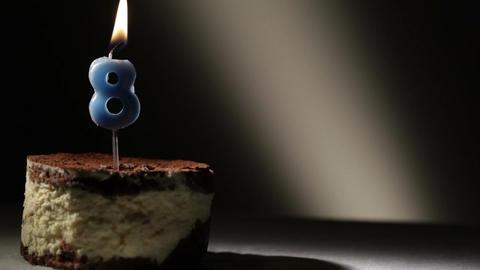 Candle eight in tiramisu cake Stock Video Footage