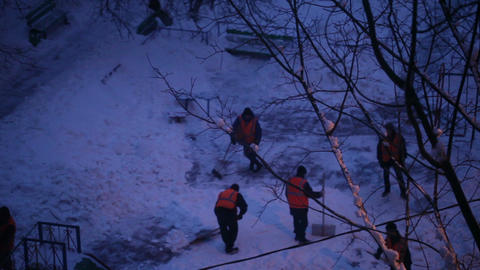 Street cleaners in orange uniform removing the snow. Real... Stock Video Footage