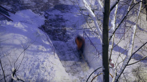 Street cleaner in orange uniform removing the snow. Time... Stock Video Footage