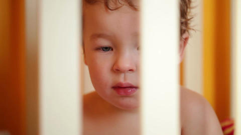Little boy watching a film sitting in the playpen. Closeup Stock Video Footage