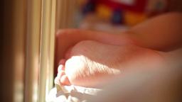 Baby's foot. Closeup. Sunlight Stock Video Footage