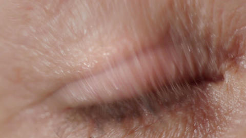 Blue eye of a middle-aged woman. Macro shot Stock Video Footage