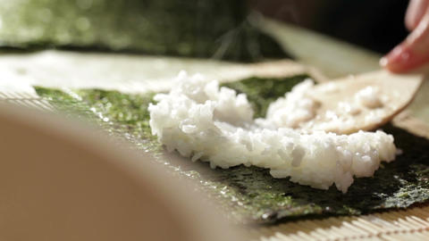 Putting rice on nori. Making sushi rolls Stock Video Footage