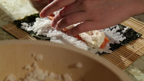Making sushi rolls with salmon and philadelphia cheese Footage