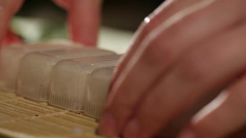 Putting rice out of the plastic form. Cooking sushi Stock Video Footage