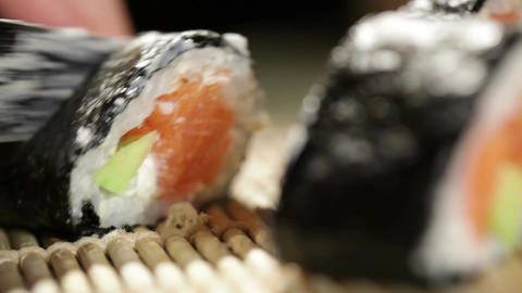 Cutting sushi rolls. Beautiful macro with shallow dof Stock Video Footage