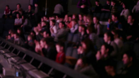 Defocused people applaud at theatre Stock Video Footage