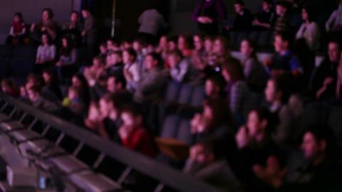 Defocused people applaud at theatre Stock Video Footage
