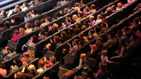 Anonymous people applaud at the theatre performance Stock Video Footage