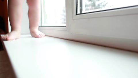 Baby legs. First steps. Slow motion Stock Video Footage