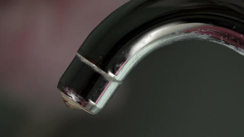 Water drips from the tap. Macro shot with sound Stock Video Footage