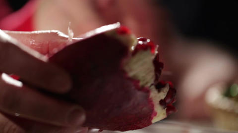 Woman's hands removes seeds from the pomegranate Stock Video Footage