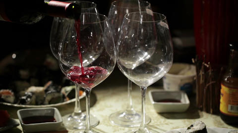 Red wine is poured in the glasses. Close up Stock Video Footage
