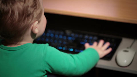 Two year old boy is playing with keyboard Stock Video Footage