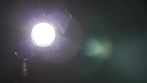 Floodlight turns on with dimmer and then turns off Stock Video Footage