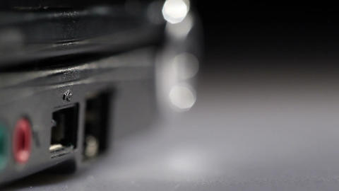 Inserting white usb flash drive in notebook. Macro shot Stock Video Footage