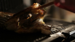 Adding lime to fish in the grill. Macro shot Stock Video Footage