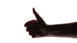 A silhouette of a woman's hand giving thumb up Stock Video Footage