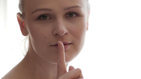 Portrait of young woman showing silence gesture on the... Stock Video Footage