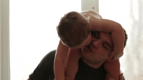 Two year old son is sitting on the father's shoulders Stock Video Footage