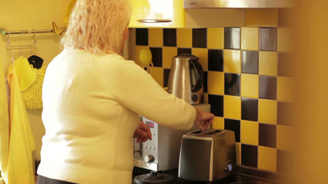 Woman Takes Two Hot Toasts From The Toaster. stock footage