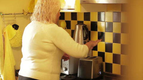 Woman takes two hot toasts from the toaster Stock Video Footage
