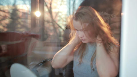 Through the window warm portrait of girl enjoying her... Stock Video Footage
