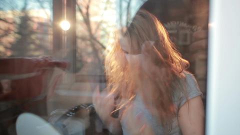 Through the window warm portrait of girl enjoying her... Stock Video Footage