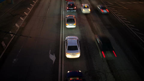Car traffic at night. Time lapse with panning Stock Video Footage