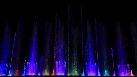 Dancing beautiful colorful fountain. Wide low angle shot Stock Video Footage