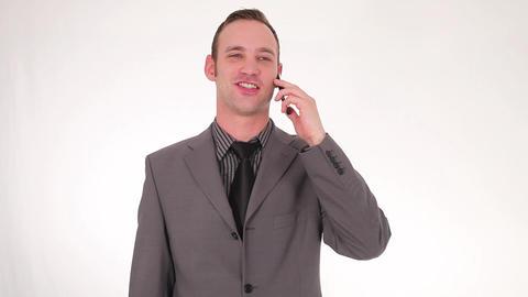 Businessman picking up smartphone Footage
