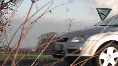 Many Cars Passing A Landscape Protection Area Sign stock footage