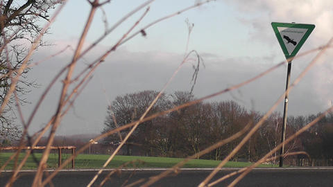 many cars passing a landscape protection area sign Stock Video Footage