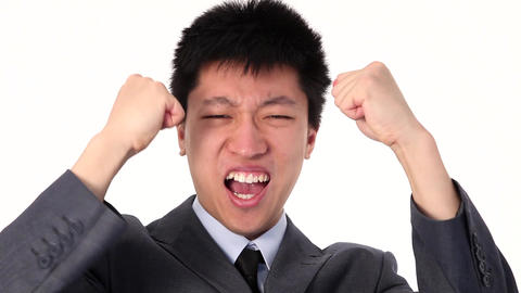 Happy Young Asian Businessman Screaming For Joy stock footage