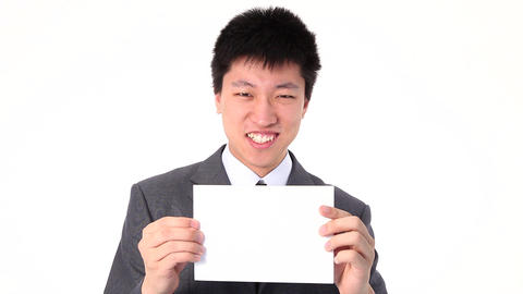 Young Asian businessman holding up a white paper Footage