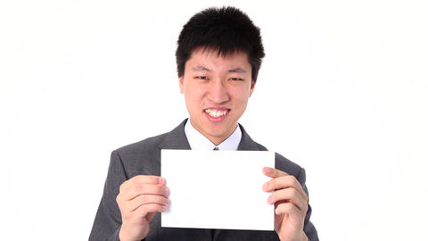 Young Asian businessman holding up a white paper Stock Video Footage
