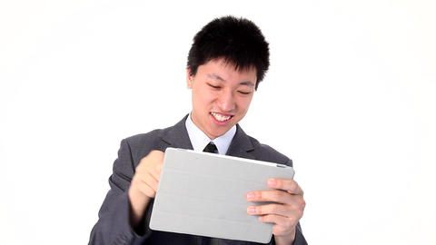 Asian young businessman using a tablet Footage