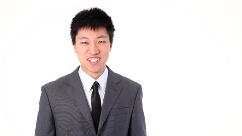 Asian young businessman talking happy on a smart phone Stock Video Footage