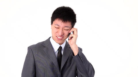 Asian young businessman talking happy on a smart phone Footage