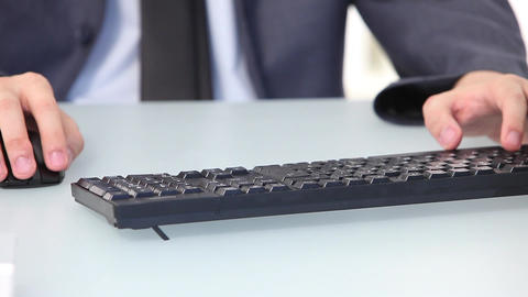 Asian man typing on a desktop keyboard, closeup of hands Stock Video Footage