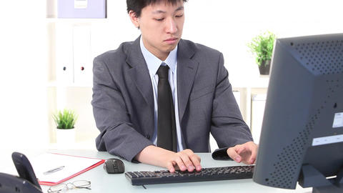 young asian businessman writes on computer Stock Video Footage