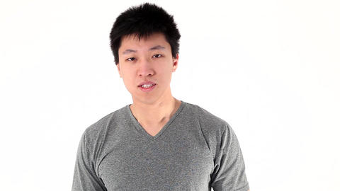 Smiling asian young man showing thumbs up gesture Stock Video Footage