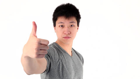 Asian young man showing thumbs up gesture Stock Video Footage