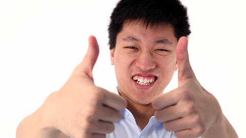 Asian young man showing two thumbs up gesture Footage