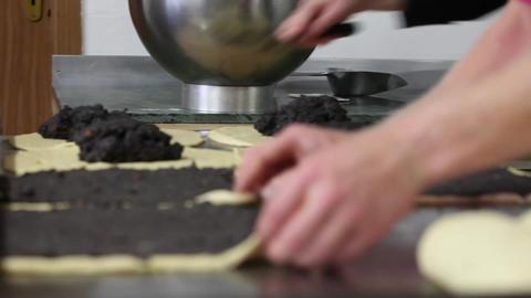 Baker rolling Poppy-Seed Stollen (Mohnstollen) Stock Video Footage