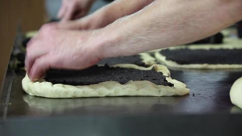 Baker Rolling Poppy-Seed Stollen (Mohnstollen) stock footage